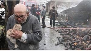 83letý muž pevně drží svou jedinou jistotu poté, co jeho dům shořel.